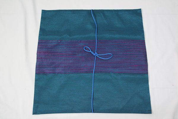 Thai cushion cover in blue green color with blue stripes