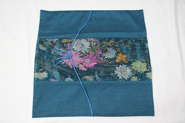 Thai cushion cover in prussian blue color with flower pattern