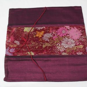 Thai cushion cover in purple color with floral pattern