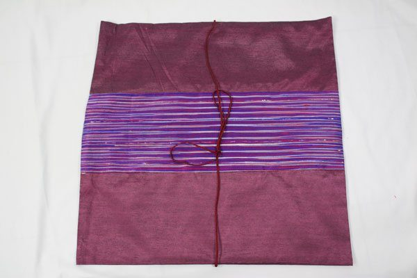 Thai cushion cover in plum color with lavender stripes