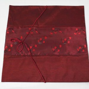 Thai cushion cover in maroon color with flower pattern