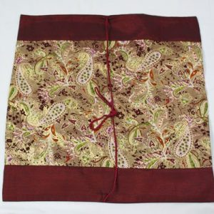 Thai cushion cover in carmine color with flower pattern