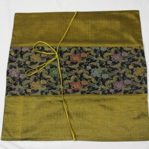 Thai cushion cover in golden color with floral pattern