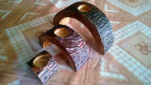 set of three mango wood candle holder with rustic finishing