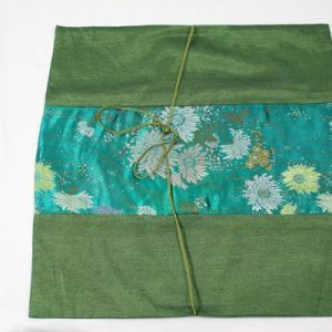 Thai cushion cover in green color with flower pattern