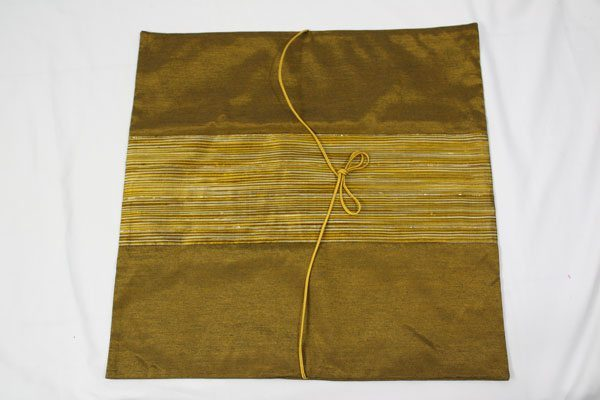Thai cushion cover in golden color with golden stripes