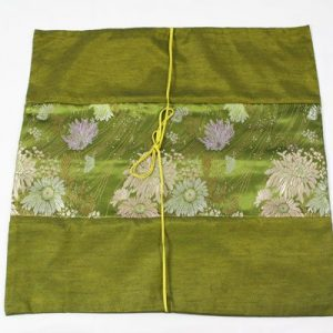 Thai cushion cover in green golden color with floral pattern