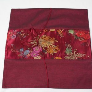 Thai cushion cover in pumple color with floral pattern
